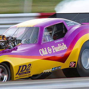 The DeCort Brothers' Old & Fuelish and their trademark smokey burnouts are always a crowd pleaser. Chuck Clark Photo.